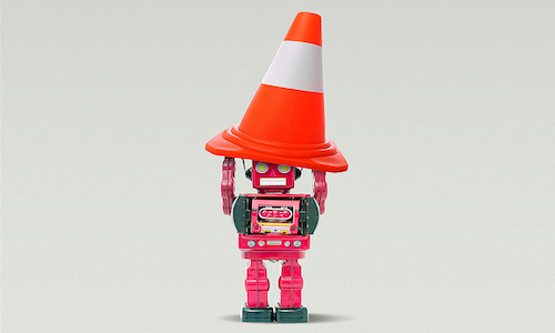 A toy robot holding a traffic cone.